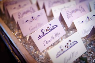 white-seating-cards-with-purple-script-and-rhinestones