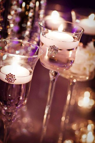 glass-candlestick-with-floating-white-candle-and-crystal-brooch