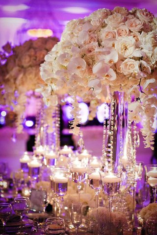 white-rose-and-orchid-centerpiece-with-hanging-crystals