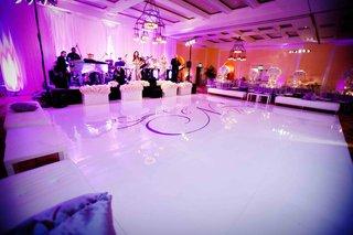 monogram-dance-floor-with-purple-lighting-and-lounge-furniture