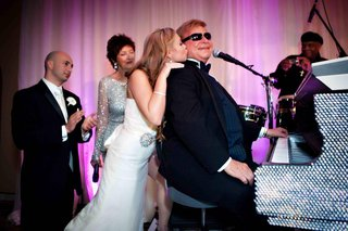 bride-kisses-grandpa-in-law-on-cheek-at-crystal-piano