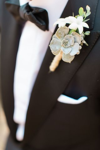 groom-with-bow-tie-and-tuxedo-with-rustic-boutonniere-succulent-twine-stephanotis-greenery