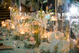 glass-vessels-filled-with-flowers-and-floating-candles