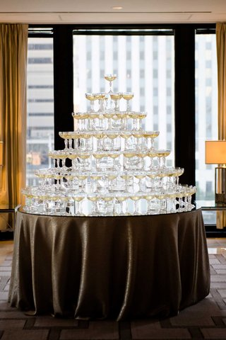 wedding-reception-city-view-chicago-large-mirror-table-coupe-glass-champagne-tower