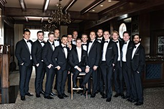 groom-in-white-tie-and-tuxedo-groomsmen-in-black-ties-and-tuxedos-large-group-of-groomsmen