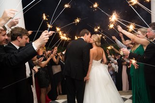bride-and-groom-kiss-under-tunnel-of-sparklers