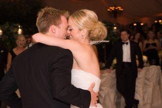 bride-and-groom-on-dance-floor-kissing