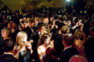 wedding-attendees-dancing-at-tented-reception