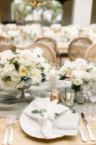 wedding-reception-long-wood-table-linen-runner-white-garden-rose-eucalyptus-centerpiece-candles