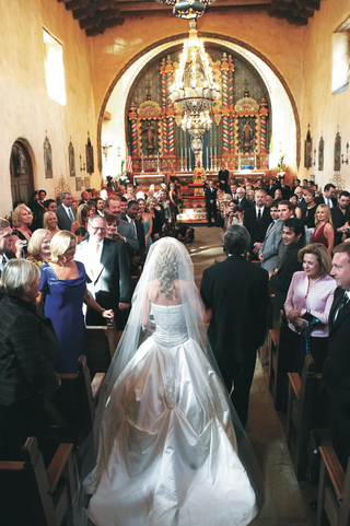 bride-walking-down-aisle-with-father-in-church
