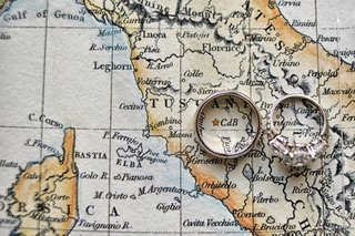 three-stone-diamond-engagement-ring-and-wedding-band-on-a-map-of-tuscany