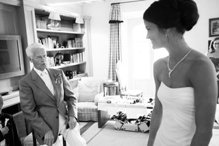 black-and-white-photo-of-bride-in-a-strapless-vera-wang-gown-with-loved-one