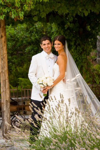 bride-in-a-strapless-vera-wang-gown-with-groom-in-a-tuxedo-with-white-coat-and-bow-tie