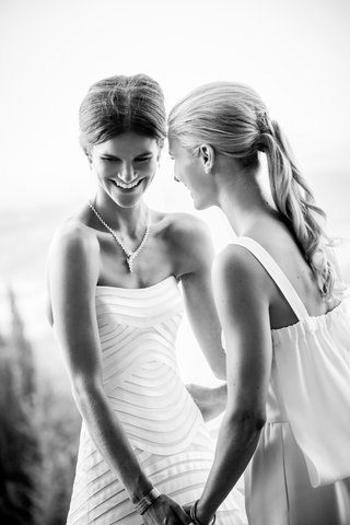 black-and-white-photo-of-bride-in-a-vera-wang-gown-with-a-bridesmaid