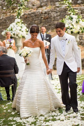 bride-in-a-strapless-vera-wang-gown-with-champagne-bands-with-groom-in-tuxedo-with-white-coat-exit