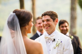 bride-and-groom-exchange-vows-at-outdoor-ceremony-in-tuscany
