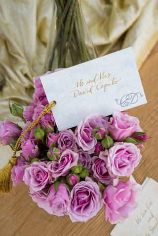 bouquet-of-light-purple-roses-with-a-card-with-gold-script-and-couples-monogram
