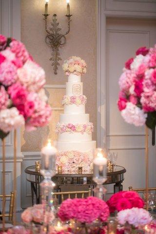 wedding-reception-ballroom-white-pink-ivory-cake-fresh-flowers-monogram-on-mirror-table