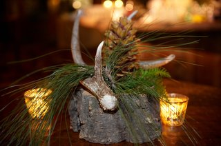 wood-antler-and-pinecone-centerpieces