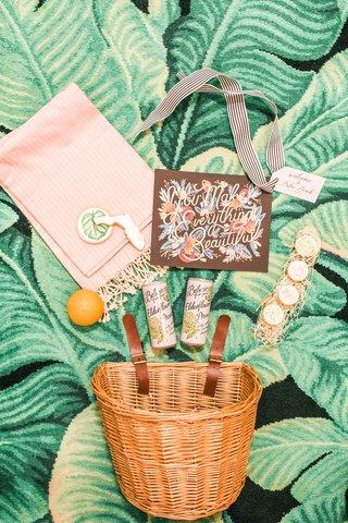 welcome-basket-with-belvoir-elderflower-drink-macarons-an-orange-and-cookies-palm-print-florida