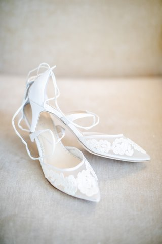 pointed-toe-bridal-shoes-with-lace-floral-appliques-and-lace-up-details