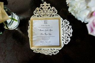 wedding-invitation-gold-black-white-color-palette-metallic-laser-cut-design-monogram-ornate-design