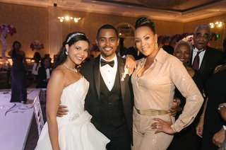 bride-and-groom-with-vivica-a-fox-wearing-tan-collared-jumpsuit-to-wedding