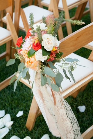rose-and-dahlia-bouquet-wrapped-with-ecru-lace-on-chair