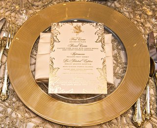 gold-rimmed-charger-plate-textured-linens-champagne-napkin