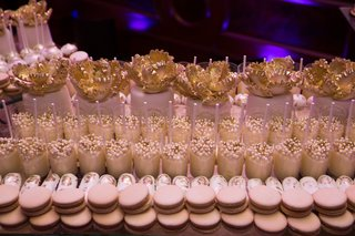 wedding-dessert-table-with-macarons-small-cakes-with-golden-fondant-peonies-pudding-cups-with-bead