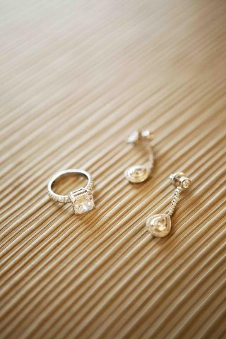 princess-cut-diamond-engagement-ring-and-drop-earrings