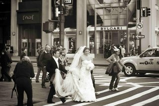 black-and-white-photo-of-bride-and-groom-walk-through-nyc-by-bvlgari