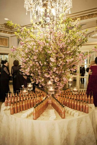 champagne-bottles-with-straws-on-seating-card-table
