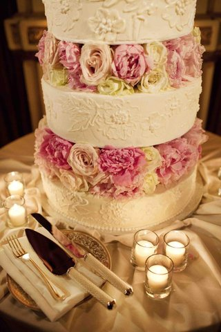 white-wedding-cake-with-flower-motif-and-peony-rose-layers