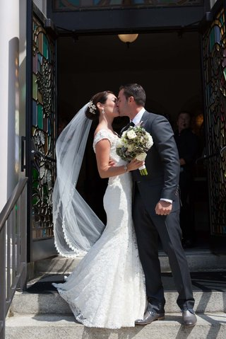 john-colaneri-co-host-of-kitchen-cousins-kisses-his-bride-at-jesus-saviour-church-newport