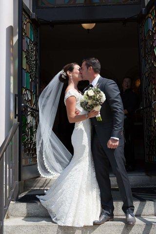 john-colaneri-co-host-of-kitchen-cousins-kisses-his-bride-at-jesus-saviour-church-newport