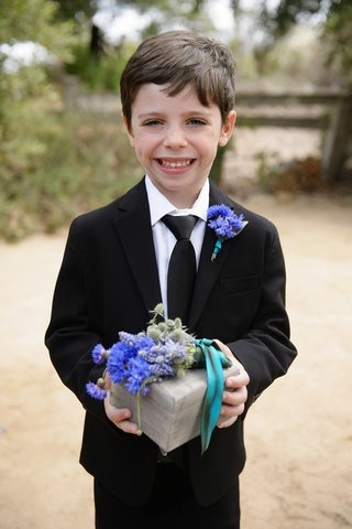 boy-smiling-in-suit-with-blue-and-purple-flower-ring-box