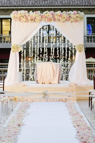 chuppah-with-white-drapery-blush-and-ivory-roses-and-hanging-orchids