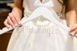 wedding-gift-idea-white-hanger-with-bow-and-pearls-and-personalized-wire-hanger
