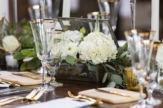 rustic-reception-tablescape-with-glass-box-open-with-white-flowers-bursting-from-it