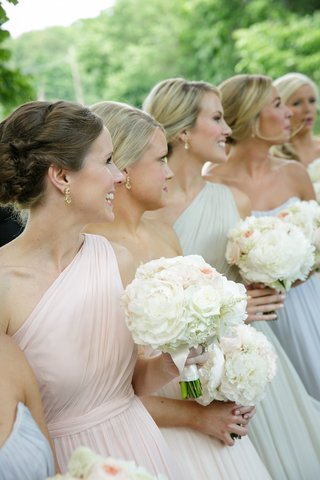 bridesmaids-in-strapless-and-one-shoulder-gowns-in-pastel-shades