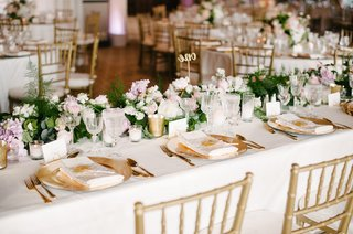 gold-charger-plate-low-centerpieces-greenery-pink-flowers-calligraphy-table-number-gold-chairs