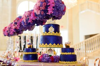 three-wedding-cakes-with-deep-blue-fondant-and-gold-border