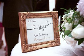 wedding-hashtag-sign-in-gold-frame-help-us-capture-the-night-use-the-hashtag-begginningforever
