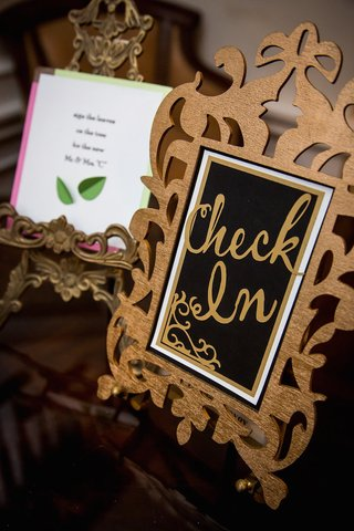 wedding-reception-with-gold-and-black-check-in-sign-in-gilt-frame-at-guest-book-table