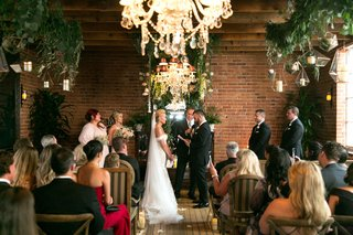 wedding-ceremony-brick-wall-urban-chic-wood-floor-brittany-daniel-and-adam-touni-actress-wedding