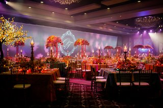 purple-lighting-and-colorful-table-centerpieces