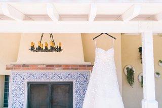 strapless-flower-applique-oscar-de-la-renta-dress-hanging-from-beams-at-the-inn-at-rancho-santa-fe