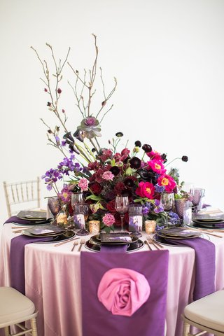 wedding-styled-shoot-pink-linen-purple-chair-cover-pink-rose-embellishment-large-centerpiece-purple