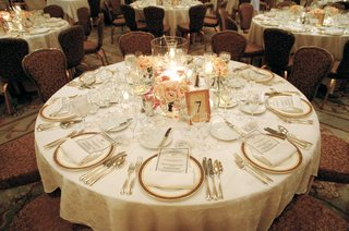 large-vase-with-candles-gold-plates-and-flatware